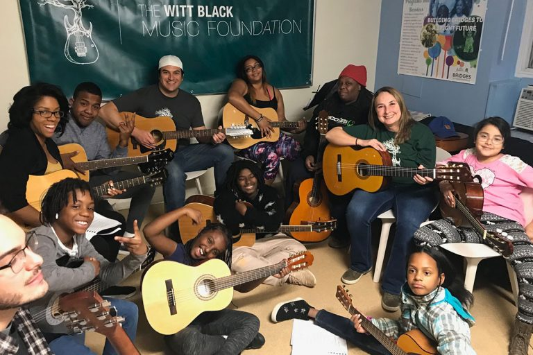 Group Learning Guitar with the Foundation